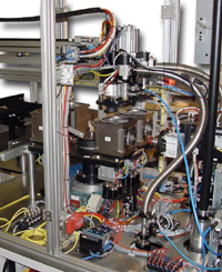 rotary table and tooling within leak test system