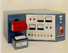 Domestic electric socket test machine.  A series of electrical and safety tests are performed.